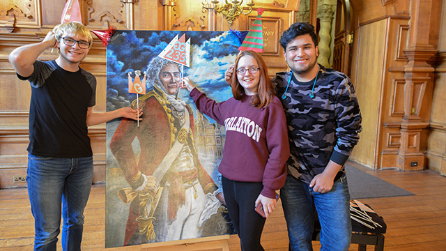 Students with painting of Gregory Gregory
